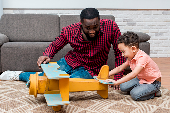 Black-Father-Son-Playing-With-Toy-Plane
