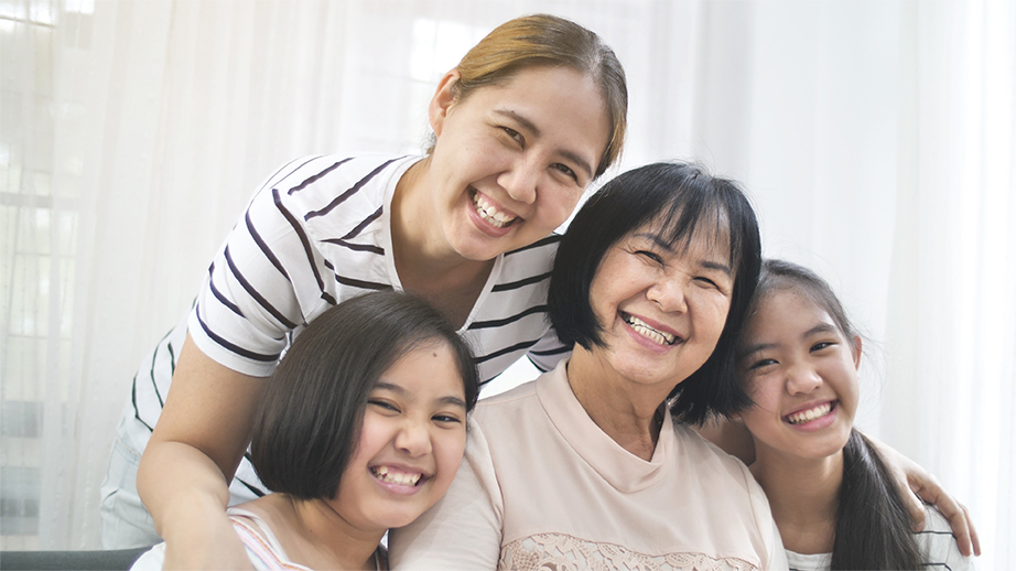 Happy-Asian-Family-Smiling-Together-Home-Multigenerational