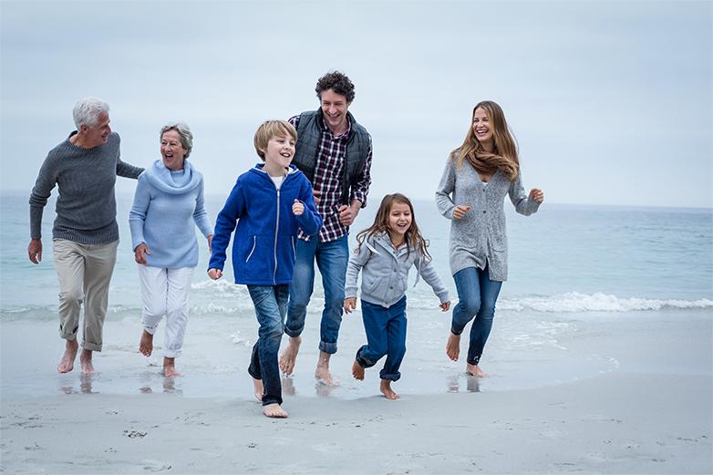 Happy-Multi-Generation-Family-Running-Sea-Shore-1