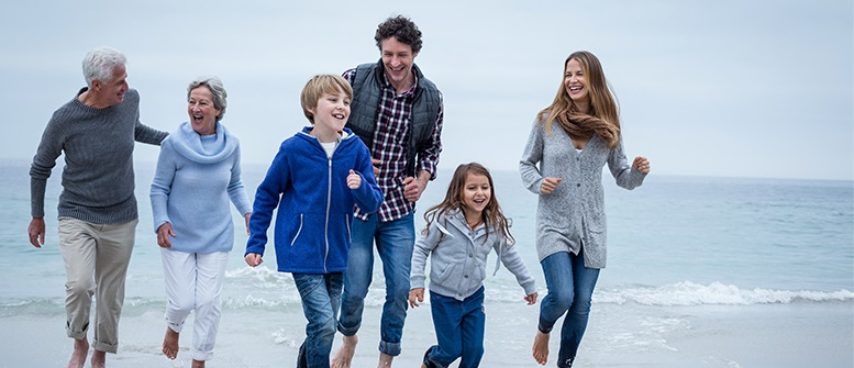 Happy-Multi-Generation-Family-Running-Sea-Shore